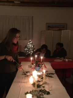 lighting candles at Community Table